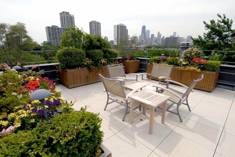 屋顶休闲花园_设计屋顶花园_屋顶阳光房的设计